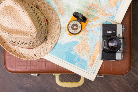 Vintage travel suitcase with map and compass