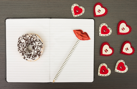 kiss biscuits: Open notebook with pencil and candy hearts