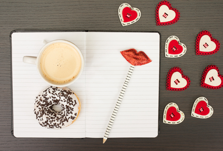 kiss biscuits: Notebook and  on a wooden background