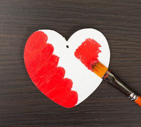 Heart painted in red with brush photo
