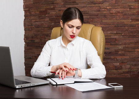 Beautiful business lady in office photo