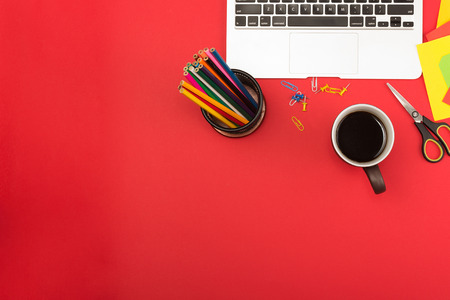 pencils  clutter: Creative messy workplace with laptop and stationery Stock Photo