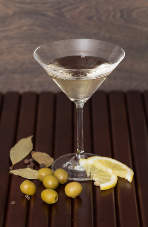 vermouth: Vermouth drink with green olives on wooden background