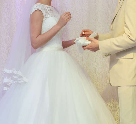 exchanging: Bride and groom holding hands and exchanging rings Stock Photo