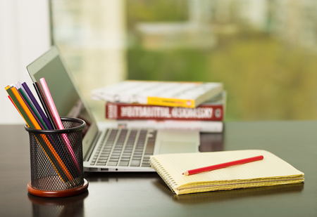 work books: Working at the laptop in an office