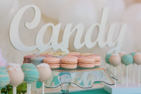 Cute candy bar with various candies and cakes Stock Photo