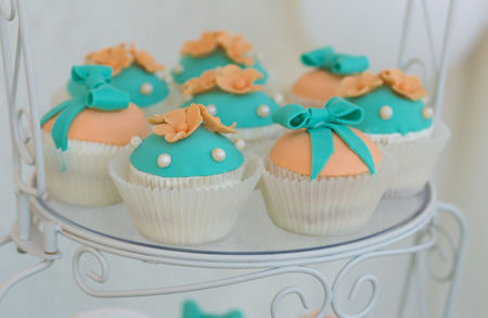 Cute cupcakes with frosting decor on a plate