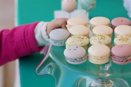 grabing: Plate with tasty multicolor macaron cookies
