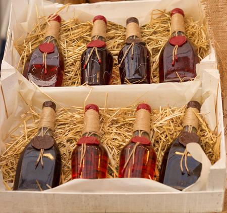 Red wine bottles in the street farmers market
