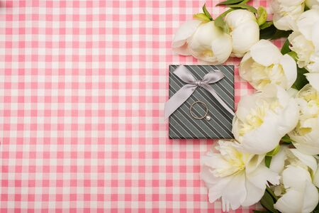 ladies day: Gift box with a bouquet of peonies on a pink background Stock Photo