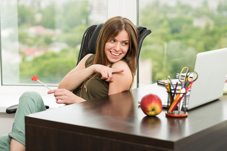 sexy business woman: Beautiful woman working at the laptop in the office Stock Photo