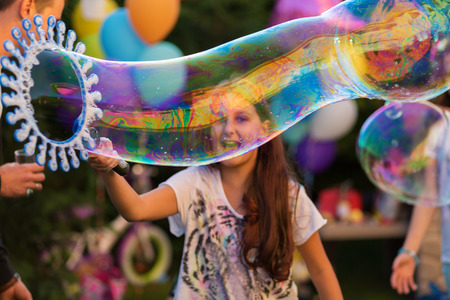 graden: Happy girl with bubbles at the graden party