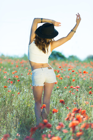 stylish girl: Beautiful stylish girl in a summer field
