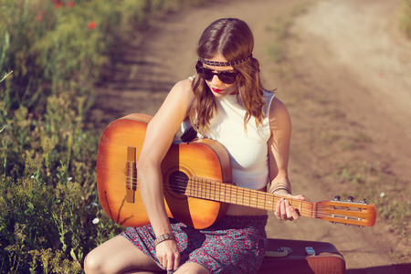 girl alone: Beautiful hippie girl alone on the countryside road Stock Photo