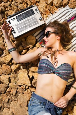 stoney: Beautiful hippie girl alone on a stoney beach