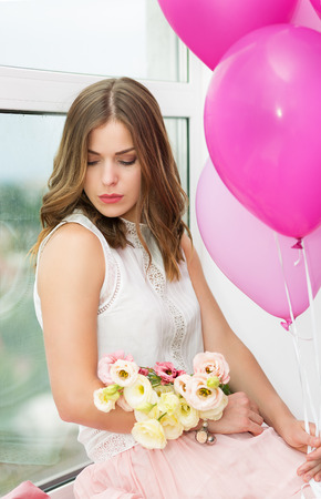 Romantic girl with flowers and balloon