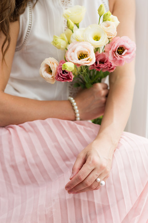 Romantic girl holding a bouquet of flowers Stock Photo