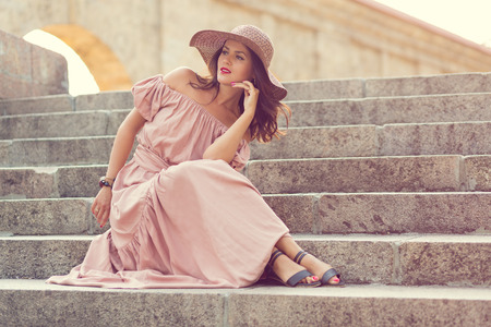 vintage woman: Retro romantic girl in the long dress standing on the stairs Stock Photo