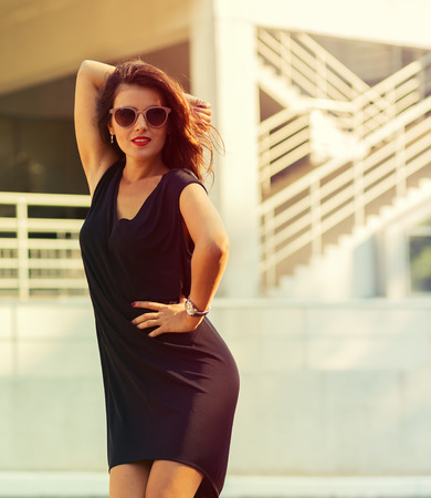 woman in dress: Stylish young woman in the big city Stock Photo