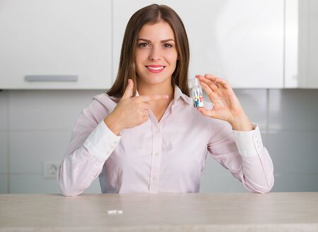 reliever: Pretty woman holding a bottle of pills