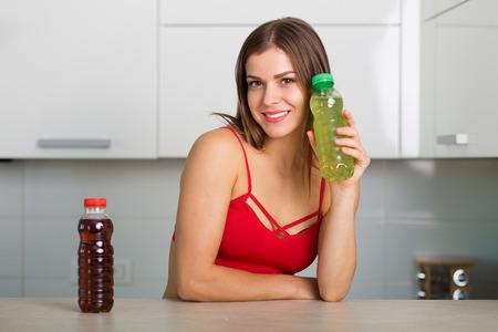 energy drinks: Woman holding two bottles of energy drinks Stock Photo