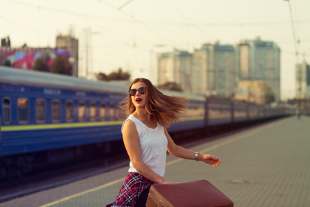 Woman waiting for a train. Retro toned image Archivio Fotografico
