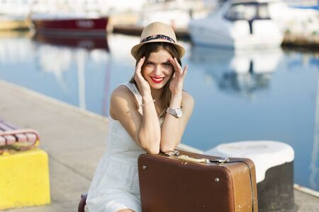chic woman: Young woman with a suitcase ready for a summer vacation