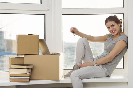 Beautiful girl moving in the new apartment Stock Photo