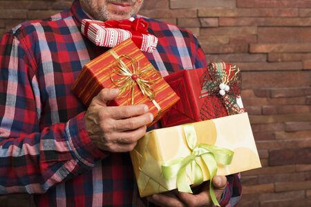 hair wrapped up: Bearded man with a bunch of present boxes