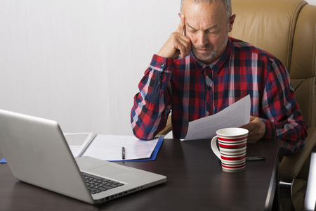 person writing: Man working with papers in the office Stock Photo