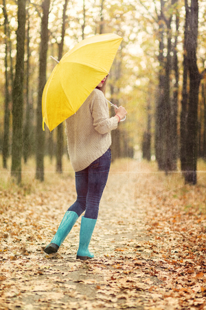 Lonely girl walking in the autumn park Archivio Fotografico