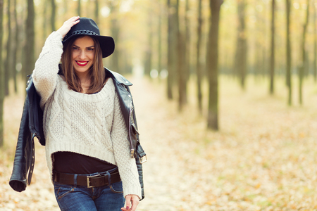 women jeans: Lonely girl walking in the autumn park Stock Photo