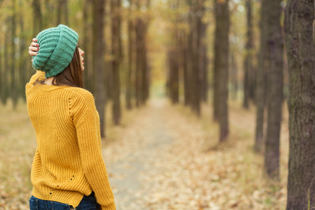 woman happy: Lonely girl walking in the autumn park Stock Photo