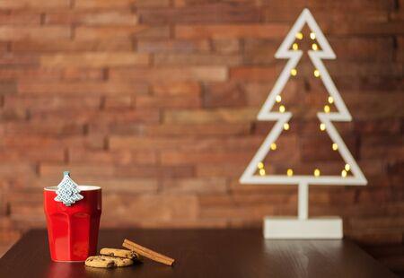 retro christmas tree: Cup of coffee, cookies and Christmas decor Stock Photo