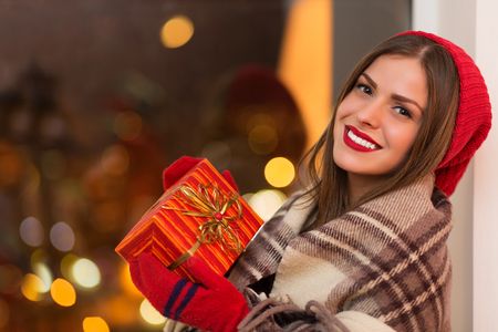 attracive: Happy young woman holding giftbox
