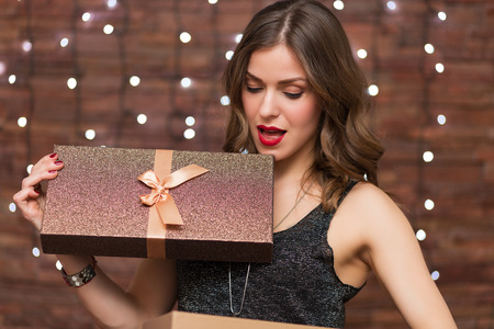 opening gift: Beautiful woman having fun at the party Stock Photo