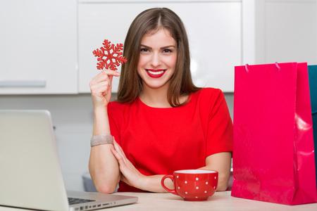 glamorous: Glamorous housewife shopping online at her laptop