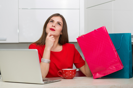 online: Glamorous housewife shopping online at her laptop