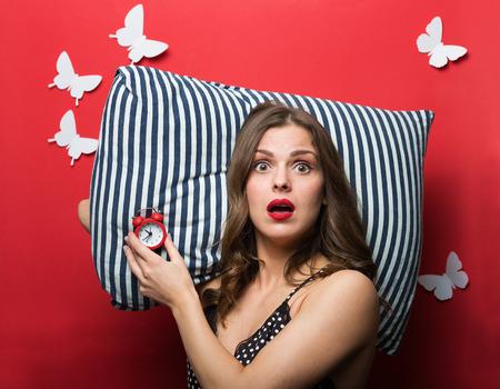 overslept: Beautiful woman in pajamas cami top Stock Photo