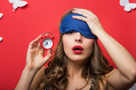 red head woman: Beautiful woman in pajamas cami top with alarm clock