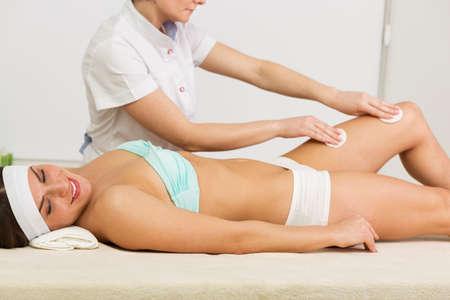 aging face: Beautiful woman having a facial massage beauty treatment Stock Photo