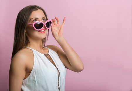 feeling happy: Pretty woman in love with pink glasses