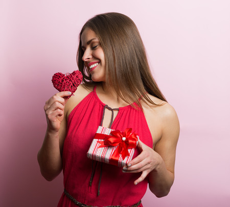 anniversary sexy: Woman in red dress holding a gift box