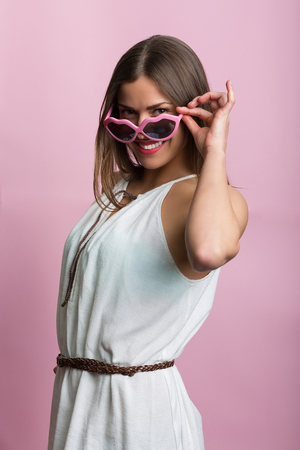 sexy pose: Pretty woman in love with pink glasses