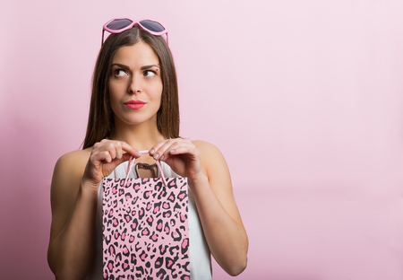 sexy pose: Pretty woman with pink glasses and shopping bag Stock Photo