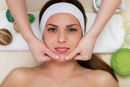 salon treatment: Beautiful woman having a facial massage beauty treatment Stock Photo