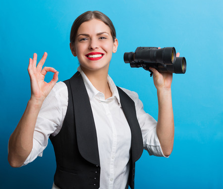 waistcoat: Pretty woman holding binoculars. Searching for new opportunities business concept