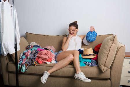 sorting: Shopaholic hipster woman at home sorting her wardrobe Stock Photo