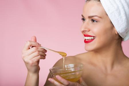 sugar paste: Woman holding sugar hair removing paste
