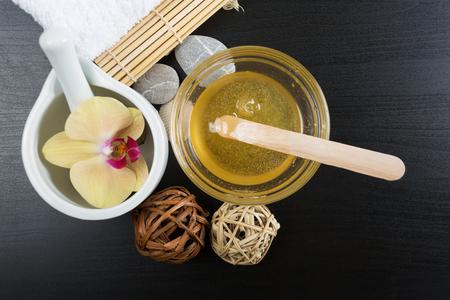 Beauty and spa treatment essentials on a dark wooden background Standard-Bild